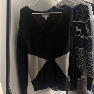 Black and gold v-neck sweater